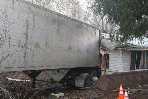 5 hospitalized after tractor-trailer crashes into St. Mary's Co. house