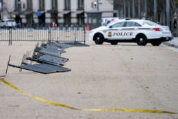 Barricade fencing is knocked over in front of the White House on Pennsylvania Avenue as the region experiences high winds, Friday, March 2, 2018 in Washington. (AP Photo/Andrew Harnik)