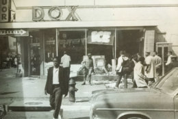 Scattered crowds in front of a looted store. (Courtesy D.C. Fire and EMS Museum)
