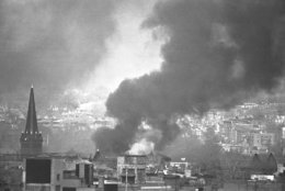 Smoke rises from burning buildings in downtown Washington on April 5, 1968 as renewed looting and arson broke out, in the nation's capital. Troops were ordered into the downtown area. (AP Photo/Charles Tasnadi)
