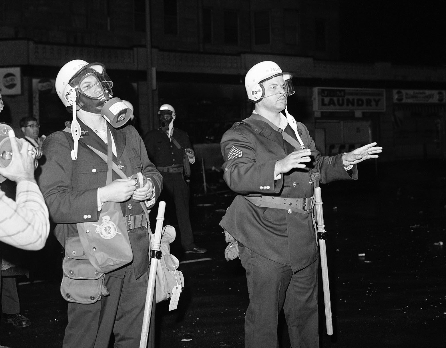 Police fire tear gas to scatter crowd at 14th and Euclid Streets in an African American section of northwest Washington on April 5, 1968. Stores were looted and fires started in reaction to assassination of Dr. Martin Luther King Jr. (AP Photo/Charles W. Harrity)