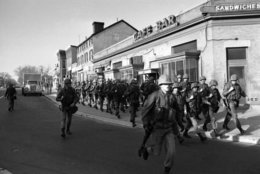 U.S. Marines move along 8th Street near M Street in southeast Washington on April 6, 1968. The Marines were among some 12,500 troops ordered into the city as new fires flared and looters roamed the streets. (AP Photo/Bob Schutz)