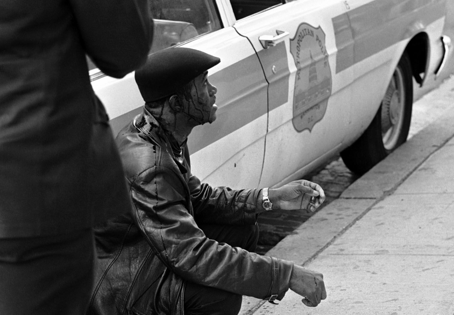 Man was arrested after police reported he fled a house, armed with a .22 caliber pistol, at 11th and K Streets, N.W., on April 7, 1968. He was taken into custody, the police reported, without any shots being fired. (AP Photo/Charles W. Harrity)