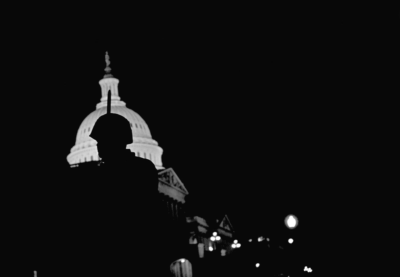 A soldier with bayonet showing above his helmet is silhouetted as he stands guard at the nation's capitol in Washington, April 8, 1968. He was one of thousands of Federal troops on duty in Washington in wake of looting and rioting. (AP Photo/Charles Harrity)