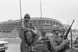 Several hundred of the Federal troops on duty in wake of violence in Washington area on April 11, 1968, watched the Minnesota Twins defeat the Washington Senators 5-4. (AP Photo/Harvey Georges)