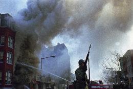 Firemen and the National Guard were called out to quell rioting that broke out in Washington following the news of the assassination of Dr. Martin Luther King Jr., April 6, 1968.  (AP Photo)
