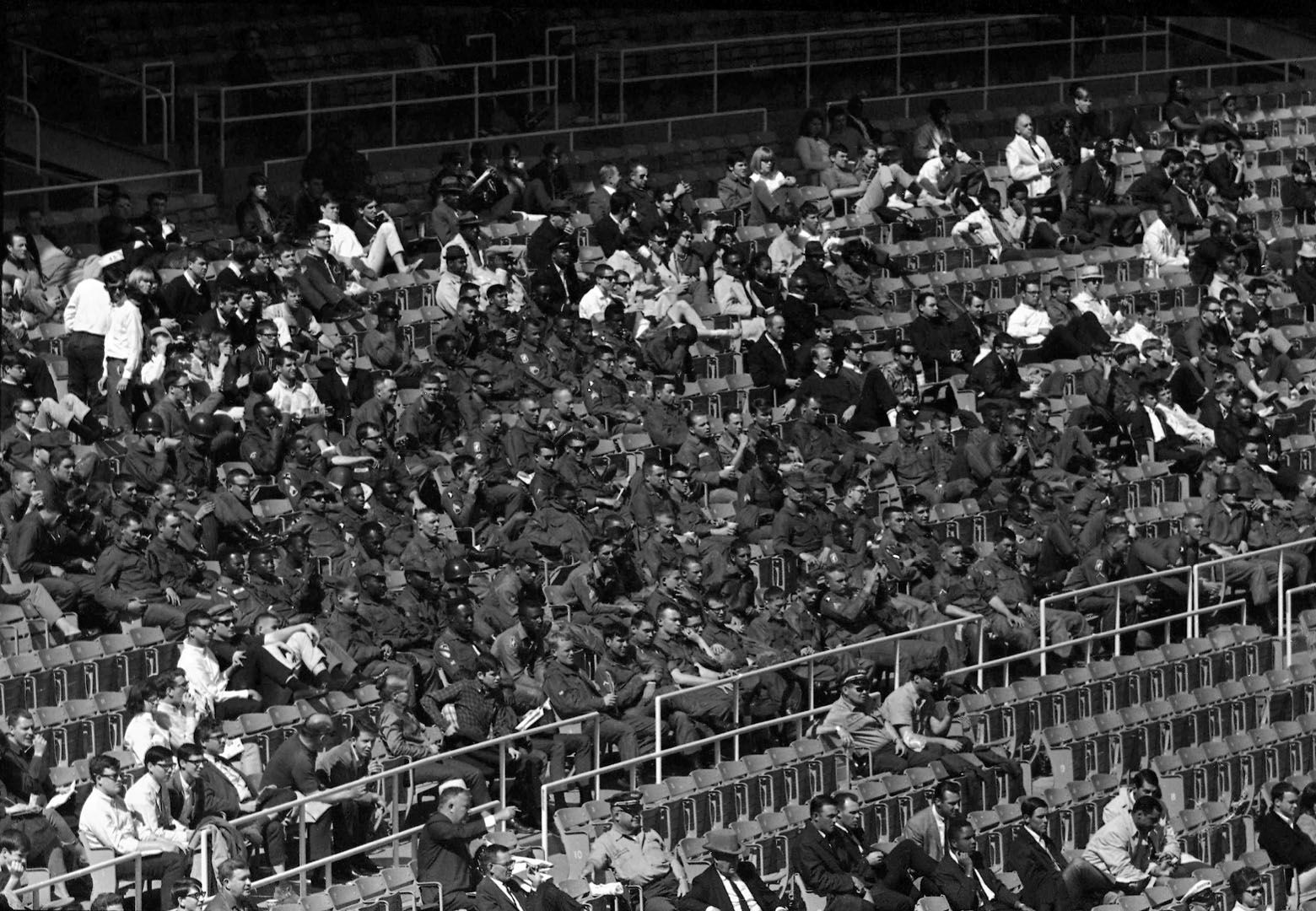 As more than 32,000 fans watch the baseball opener in the District of Columbia Stadium in Washington on April 10, 1968, in background, these troopers of the 82nd Airborne Division went about their patrolling outside. They are part of the federal forces sent into the Washington area when racial violence broke out several days before. Inside the stadium, the Minnesota Twin defeated the Washington Senators, 2-0. The 82nd Division is based at Fort Bragg, N.C. (AP Photo/Charles Tasnadi)