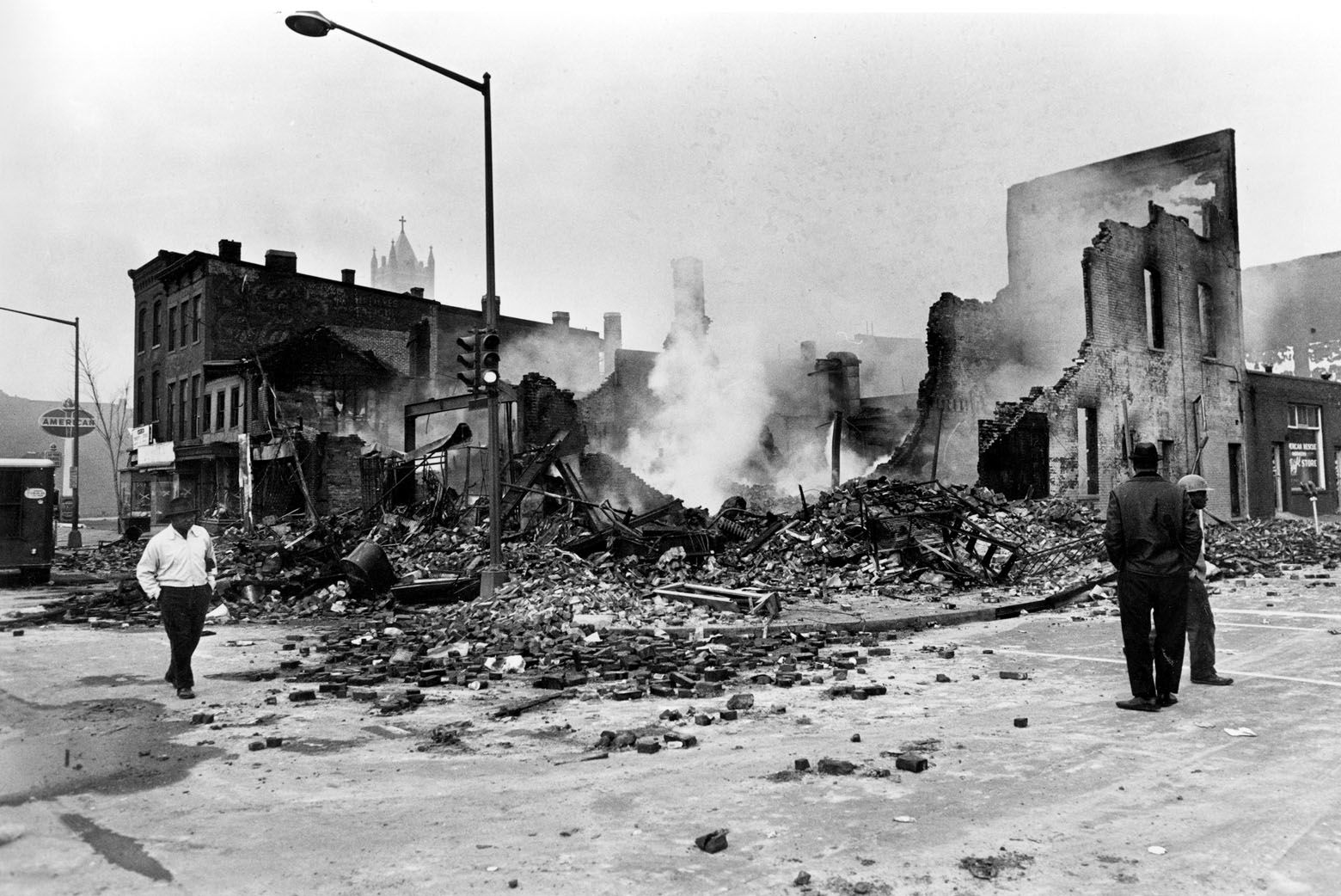 Smouldering ruins remain where a building stood on 7th Street, N.W. in Washington, D.C., April 6, 1968.  Numerous fires accompanied the second night of turmoil in the nation's capital following the assassination of Dr. Martin Luther King, Jr., in Memphis, Tenn., April 4.  (AP Photo)
