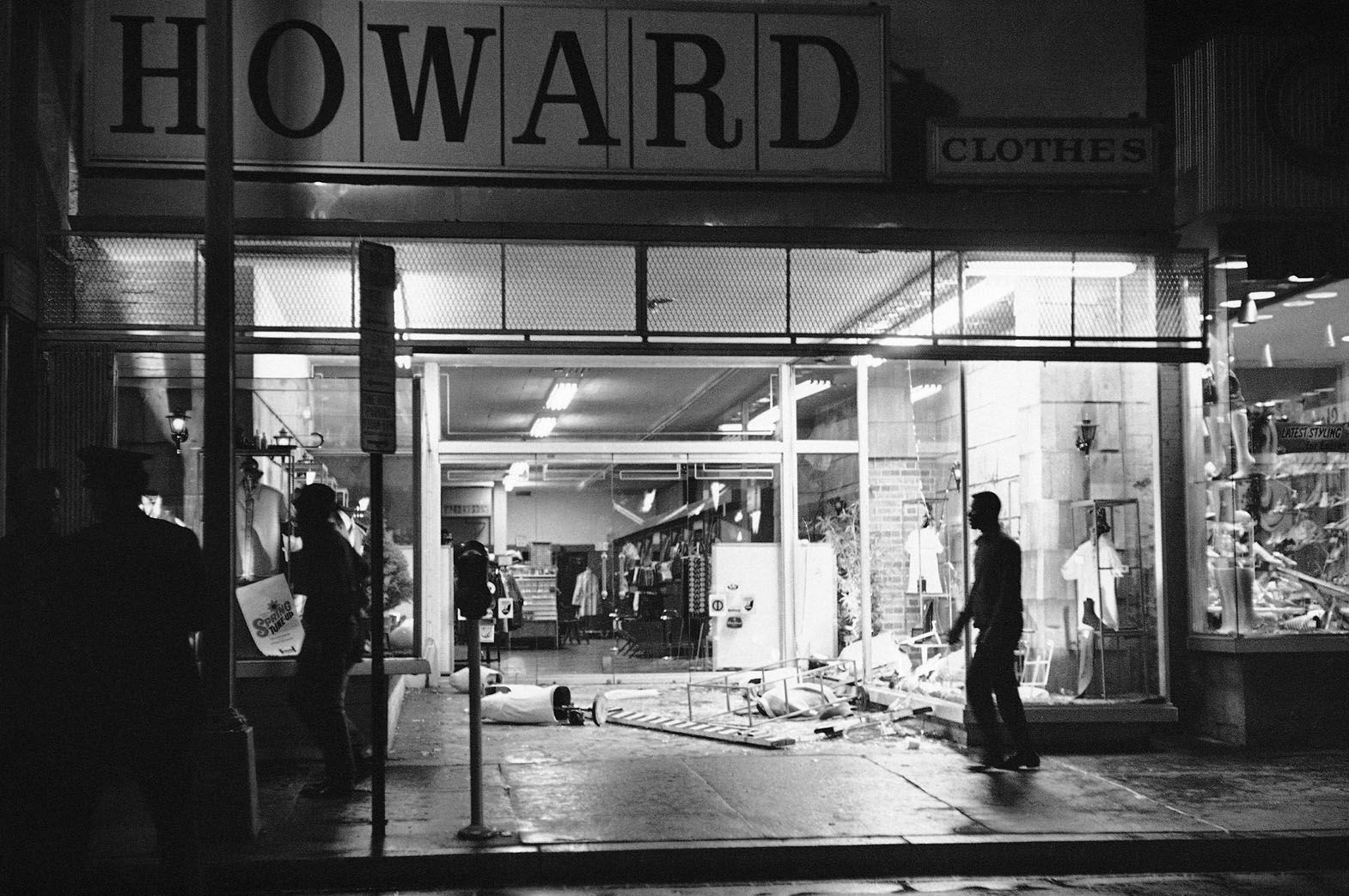 Glass and mannequins litter sidewalk at this clothing store in Northwest Washington, April 4, 1968 after crowds in the predominantly black neighborhood broke into and looted some stores. Crowds gathered following news that Dr. Martin Luther King Jr. had been slain. (AP Photo/Charles Harrity)