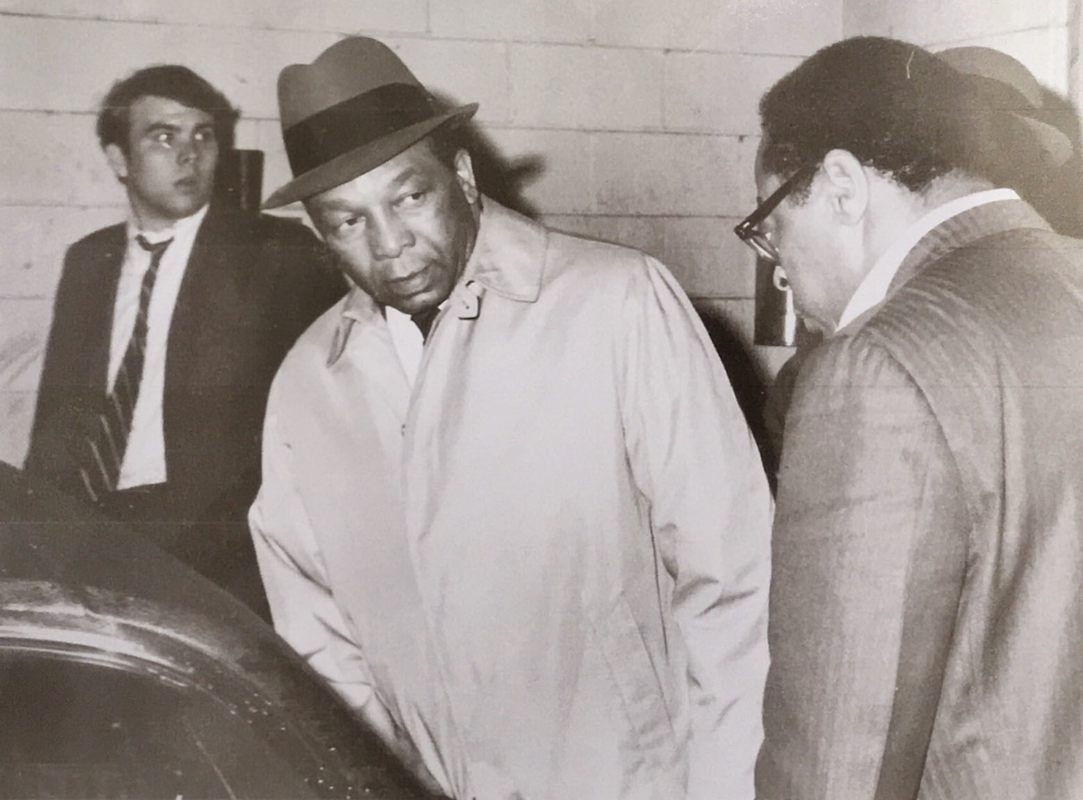 Mayor Walter E. Washington (center) prepares for a near-midnight tour of the damage after window-breaking, looting and arson broke out late in the evening April 4, 1968 after the assassination of Dr. Martin Luther King in Memphis. Paul Delaney (in foreground) hopped in the back of the mayor's car for a backseat view of history as the nation's first black mayor surveyed the destruction in the city. (Courtesy Paul Delaney)