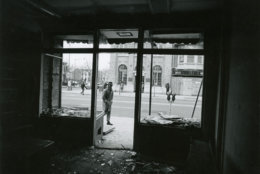 Broken windows and shattered glass in a battered store. Reprinted with permission of the DC Public Library, Star Collection, © Washington Post.