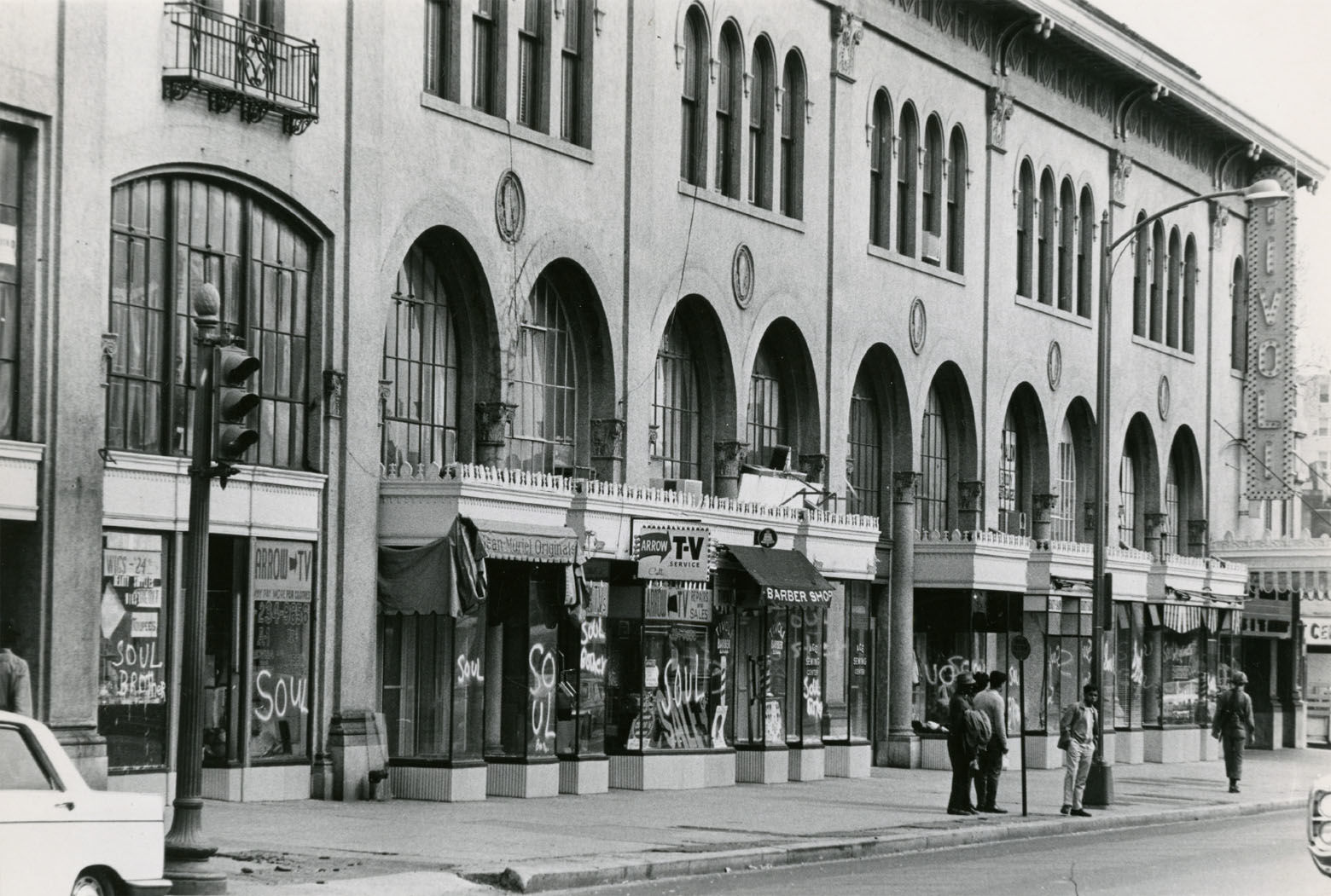 """""""Soul Brother"""" signs adorn black-owned businesses along 14th Street in Columbia Heights near the Tivoli Theater. Reprinted with permission of the DC Public Library, Star Collection, © Washington Post."""