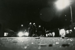 Helmeted police patrol the streets. Reprinted with permission of the DC Public Library, Star Collection, © Washington Post.