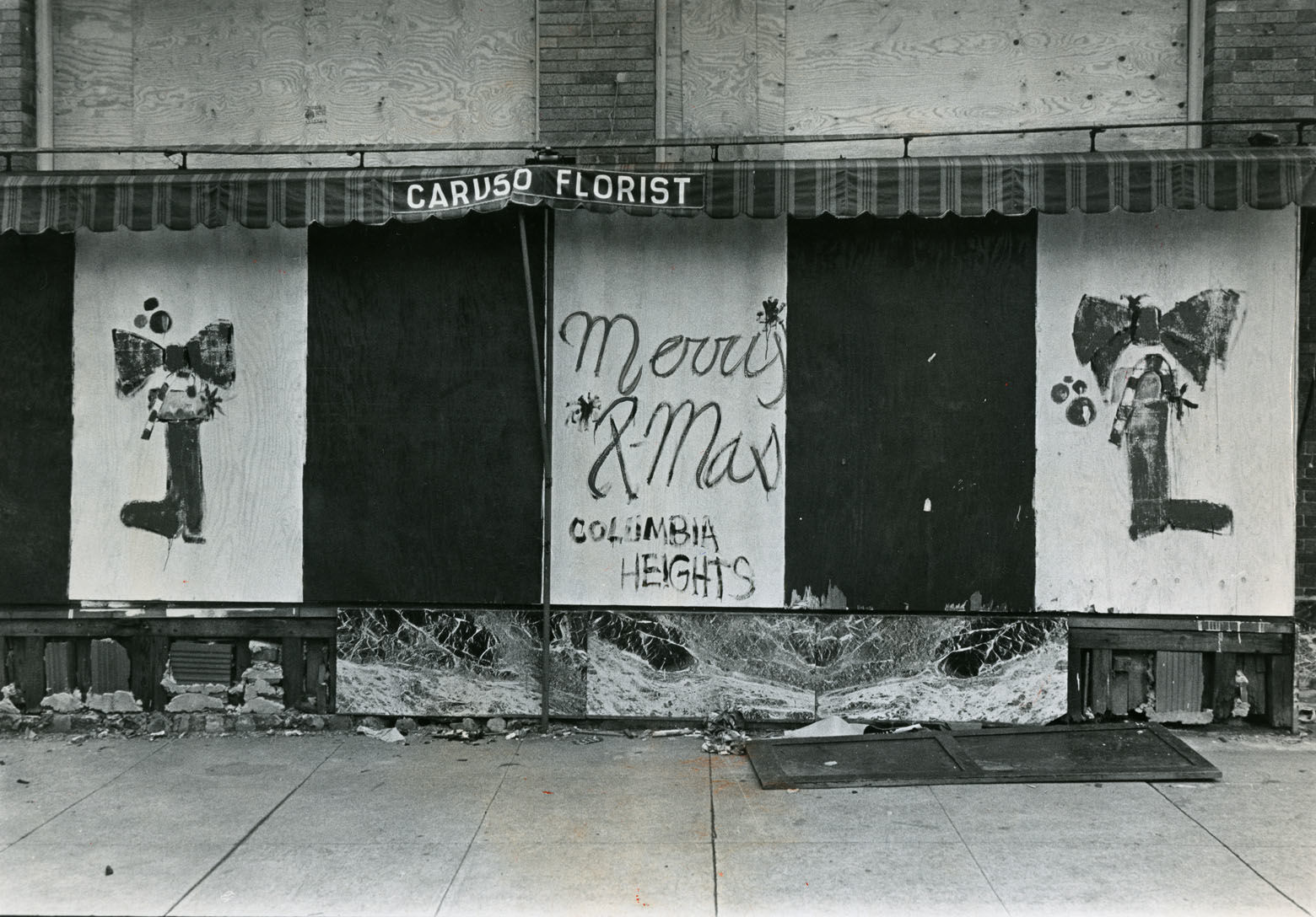 Boarded-up stores, burned-out husks of buildings and vacant lots dotted the riot corridors for month after the riots with little visible improvement. Delays in rebuilding would later span decades. Reprinted with permission of the DC Public Library, Star Collection, © Washington Post.