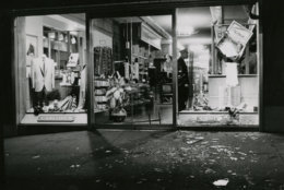 A broken window but mostly untouched merchandise. A guard inside stands watch. Reprinted with permission of the DC Public Library, Star Collection, © Washington Post.