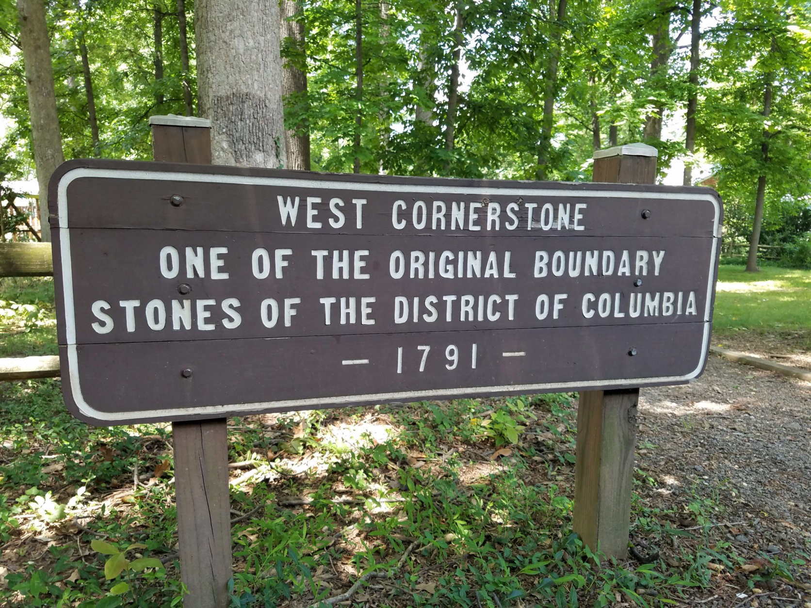 The west cornerstone rests in Andrew Ellicott Park in Falls Church. (WTOP/William Vitka)