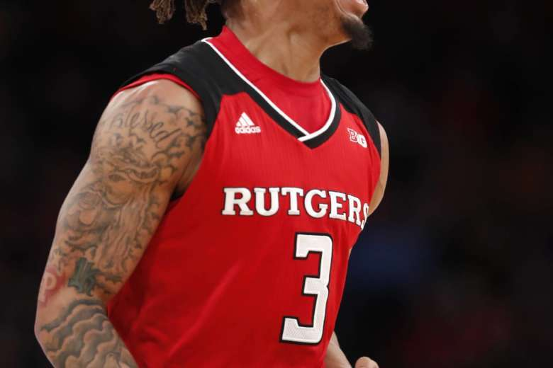 55472ea20821 Rutgers guard Corey Sanders reacts during the first half of the team s NCAA  college basketball game against Minnesota in the first round of the Big Ten  ...