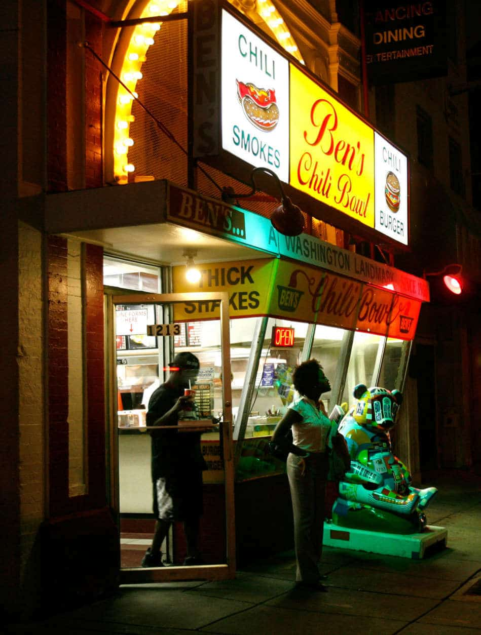 **FILE** In this file photo from Thursday, Aug. 23, 2007, customers exit Ben's Chili Bowl on U Street Northwest in Washington. (AP Photo/Jacquelyn Martin)