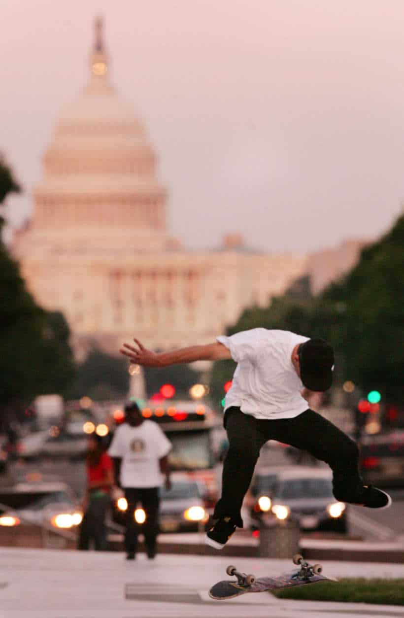 With the U.S. Capitol in the background, Mike Mascelli, of Virginia, skates at Pulaski Park, Tuesday, June 17, 2008, in Washington. (AP Photo/Haraz N. Ghanbari)
