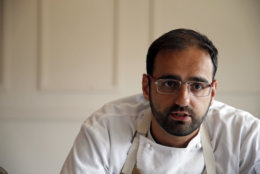 In this Tuesday, May 31, 2016 photo, Chef Alon Shaya, proprietor of Shaya Restaurant, speaks during an interview with the Associated Press at his restaurant in New Orleans. In 2015, Shaya opened his namesake restaurant, a bustling Israeli eatery on chic Magazine Street that the James Beard Foundation in May named the Best New Restaurant in the U.S. (AP Photo/Gerald Herbert)