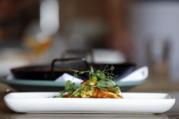 Crispy halloumi, which is a dish of spring peas, oven roasted leeks and preserved lemon, is on display at Shaya Restaurant, in New Orleans, Tuesday, May 31, 2016. (AP Photo/Gerald Herbert)