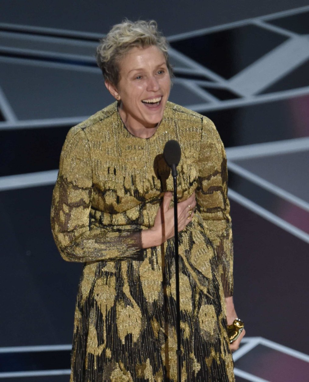 """Frances McDormand accepts the award for best performance by an actress in a leading role for """"Three Billboards Outside Ebbing, Missouri"""" at the Oscars on Sunday, March 4, 2018, at the Dolby Theatre in Los Angeles. (Photo by Chris Pizzello/Invision/AP)"""