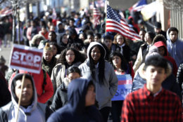 Diamond Bryant, center, a freshman at James Ferris High School walks with classmates during a student walkout, Wednesday, March 14, 2018, in Jersey City, N.J. Students across the country planned to participate in walkouts Wednesday to protest gun violence, one month after the deadly shooting inside a high school in Parkland, Fla. (AP Photo/Julio Cortez)