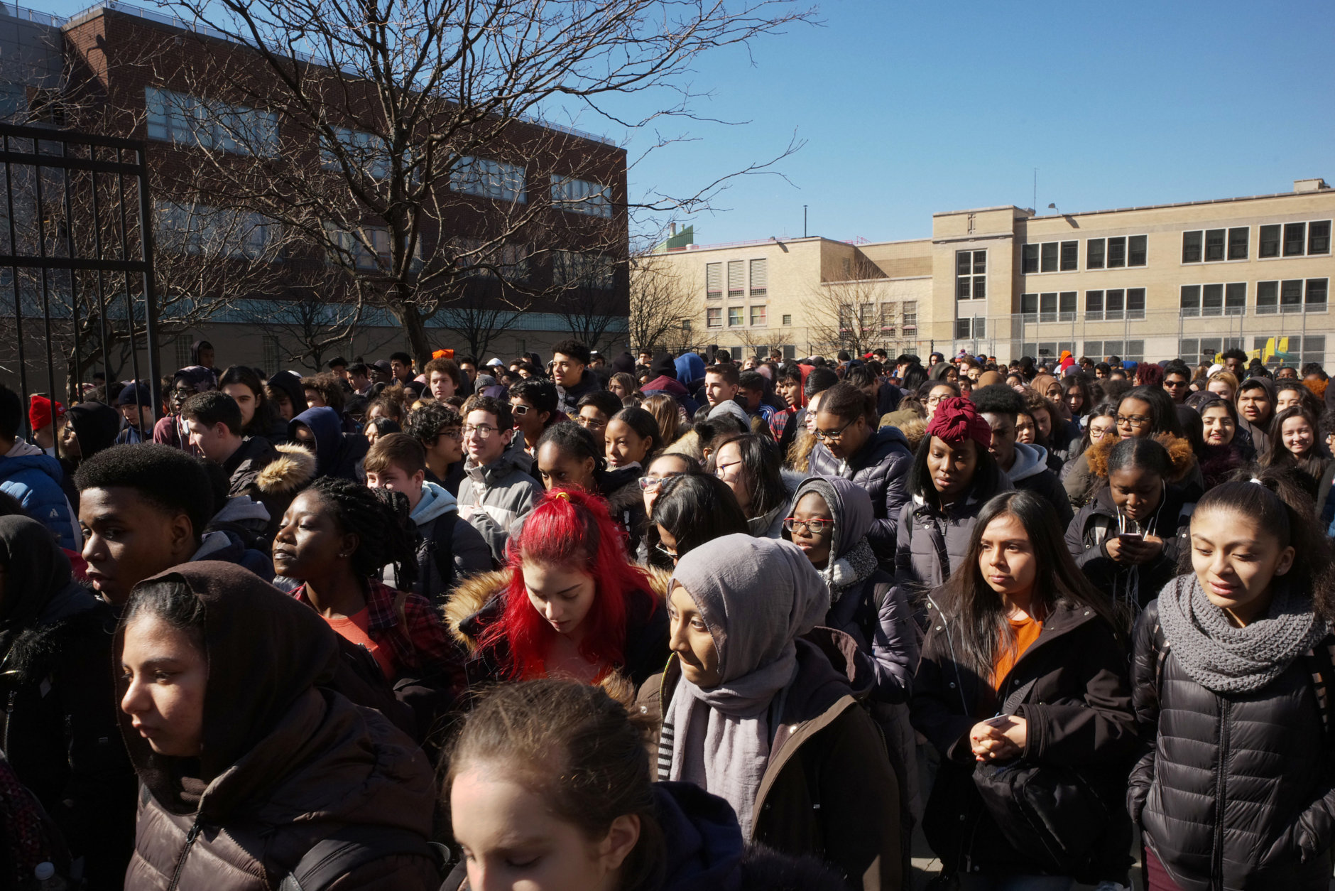 Students walk out of Midwood High School as part of a nationwide protest against gun violence, Wednesday, March 14, 2018 in the Brooklyn borough of New York. It is the nation's biggest demonstration yet of the student activism that has emerged in response to last month's massacre of 17 people at Florida's Marjory Stoneman Douglas High School. (AP Photo/Mark Lennihan)