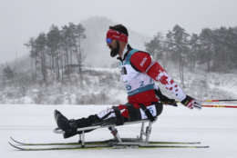 Collin Cameron of Canada competes in the Biathlon Men's 15km Sitting event during the 2018 Winter Paralympics at the Alpensia Biathlon Centre in Pyeongchang, South Korea, Friday, March 16, 2018. (AP Photo/Ng Han Guan)