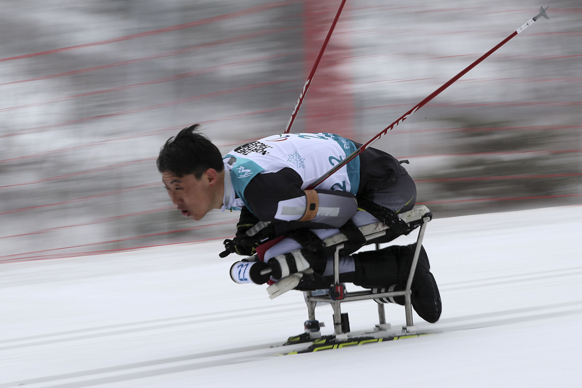 Gao Xiaoming of China competes in the Biathlon Men's 15km Sitting event during the 2018 Winter Paralympics at the Alpensia Biathlon Centre in Pyeongchang, South Korea, Friday, March 16, 2018. (AP Photo/Ng Han Guan)