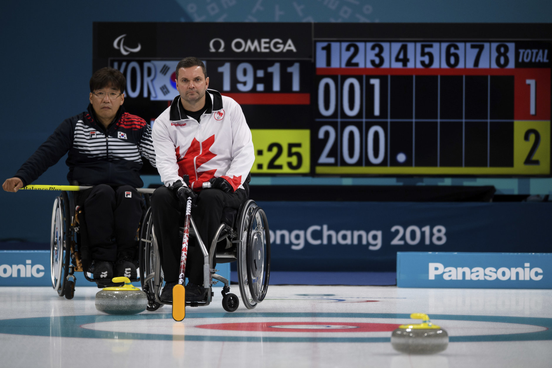 Soonseok Seo, left, of South Korea and Mark Ideson of Canada in action during the Wheelchair Curling Bronze Medal Game between South Korea and Canada at the Gangneung Curling Centre in Gangneung, South Korea at the 2018 Winter Paralympics Saturday, March 17, 2018. (Joel Marklund/OIS/IOC via AP)
