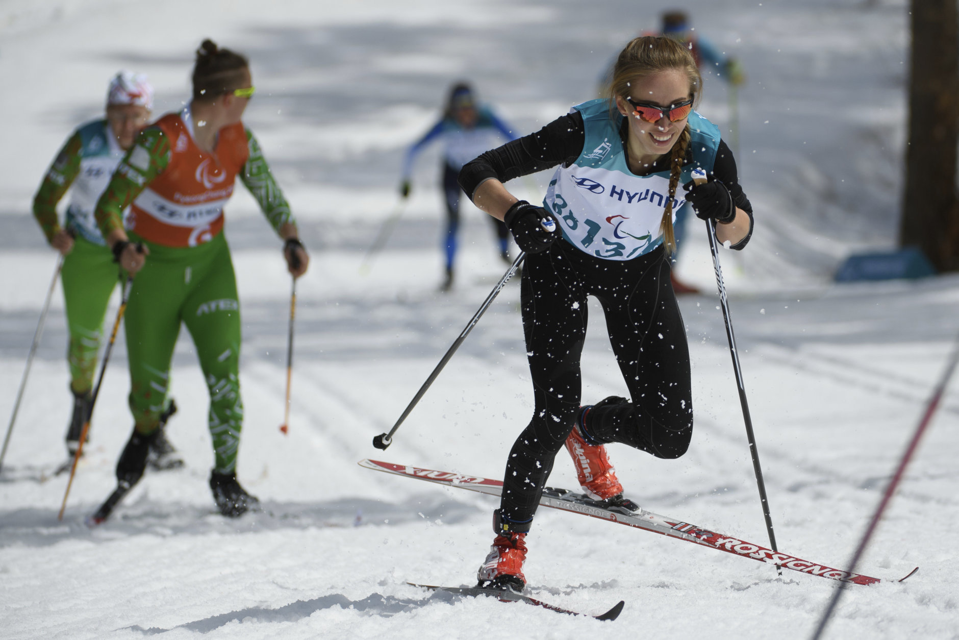 Mikhalina Lysova of Neutral Paralympic Athlete competes during the Cross Country Skiing Women's Visually Impaired 7,5km Classic at the Alpensia Biathlon Centre in Pyeongchang, South Korea at the 2018 Winter Paralympics Saturday, March 17, 2018. (Thomas Lovelock/OIS/IOC via AP)