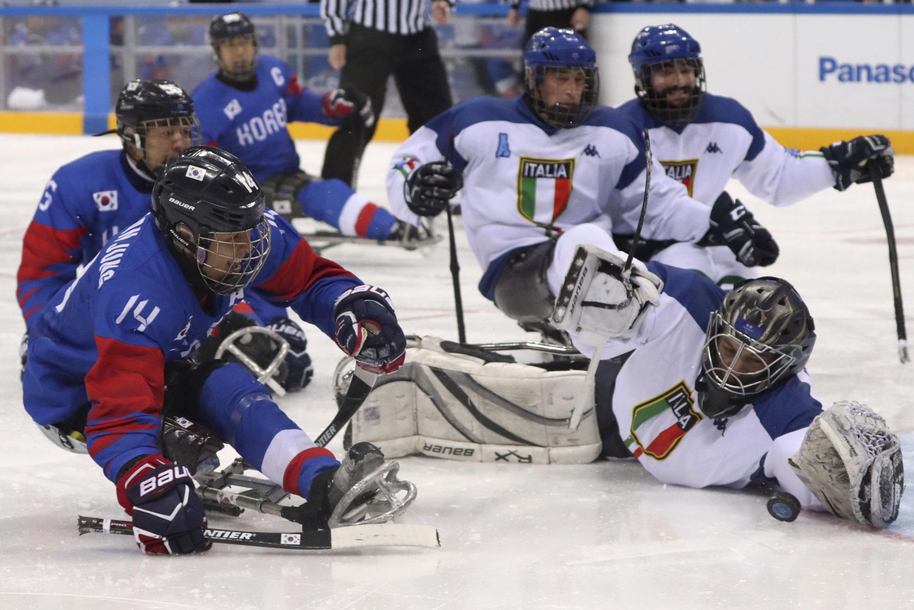 Italy's goalkeeper Gabriele Araudo blocks a shot from South Korea's Jung Seung-hwan during the bronze medal match of the 2018 Winter Paralympics at the Gangneung Hockey Center in Gangneung, South Korea, Saturday, March 17, 2018. (AP Photo/Ng Han Guan)
