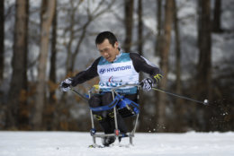 China's Lu Jingfeng competes during the Cross Country Skiing Men's Sitting 7.5km at the Alpensia Biathlon Centre, in the Paralympic Winter Games, Daengwallyeong-myeon, South Korea, Saturday, March 17, 2018. (Thomas Lovelock/OIS/IOC via AP)