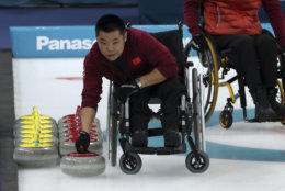 China's Liu Wei prepares a stone for his teammates as they compete against Norway in the Wheelchair Curling gold medal match for the 2018 Winter Paralympics at the Gangneung Curling Centre in Gangneung, South Korea, Saturday, March 17, 2018.(AP Photo/Ng Han Guan)