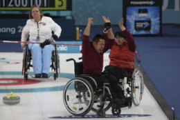 China's Wang Meng, right and Liu Wei celebrates a good throw near Norway's Sissel Loechen at left during the Wheelchair Curling gold medal match for the 2018 Winter Paralympics at the Gangneung Curling Centre in Gangneung, South Korea, Saturday, March 17, 2018.(AP Photo/Ng Han Guan)