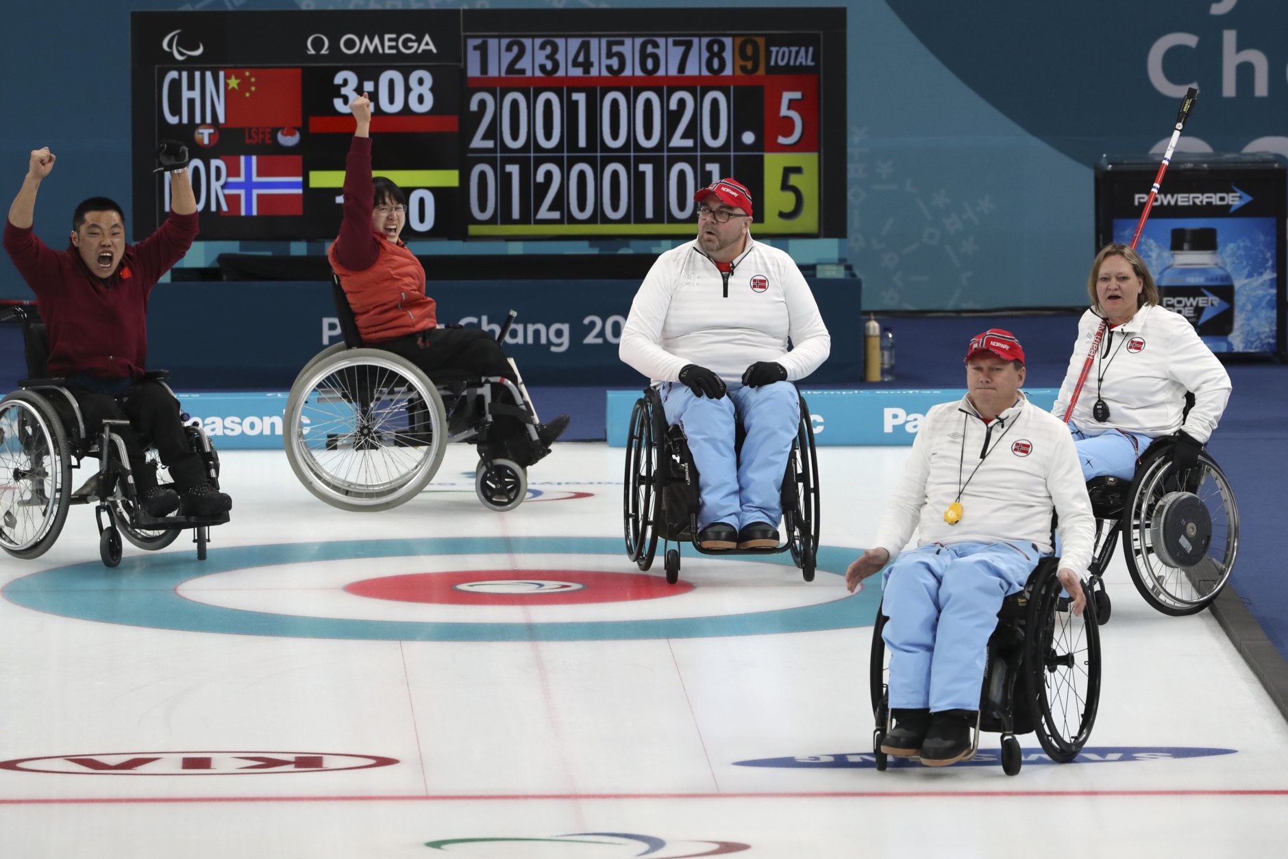 China's Liu Wei, left and Wang Meng, second from left celebrate defeating Norway's Sissel Loechen, right; Rune Lorensten, second from right and Ole Frederik Syversen, third from right during the Wheelchair Curling gold medal match for the 2018 Winter Paralympics at the Gangneung Curling Centre in Gangneung, South Korea, Saturday, March 17, 2018.(AP Photo/Ng Han Guan)