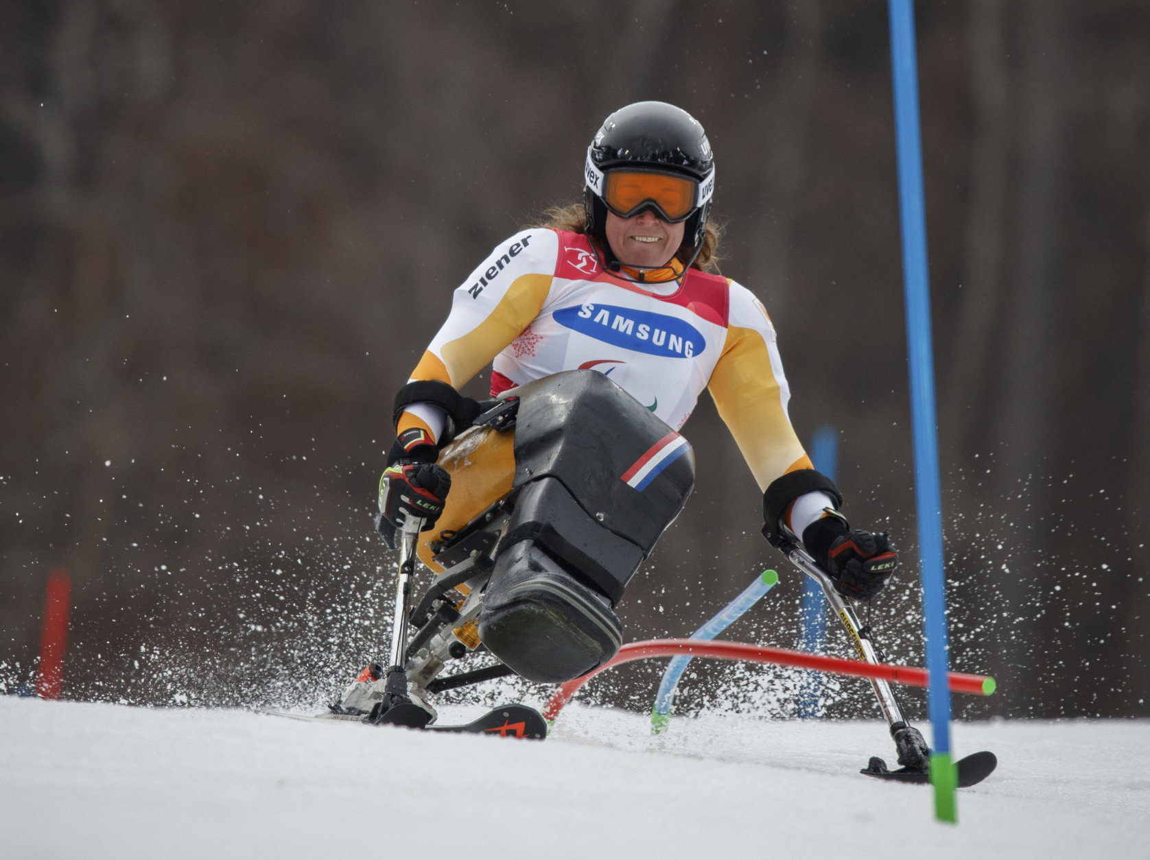 Linda Van Impelen of the Netherlands competes in the Alpine Skiing Sitting Women's Slalom at the Jeongseon Alpine Centre in Jeongseon, South Korea at the 2018 Winter Paralympics Sunday, March 18, 2018. (Simon Bruty/OIS/IOC via AP)