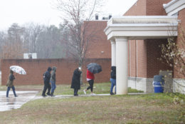 Parents arrive to pick up their children, students from Great Mills High School, at Leonardtown High School in Leonardtown, Md., Tuesday, March 20, 2018.  A teenager wounded a girl and a boy inside his Maryland high school Tuesday before a school resource officer was able to intervene, and each of them fired one more round as the shooter was fatally wounded, a sheriff said. St. Mary's County Sheriff Tim Cameron said the student with the handgun was declared dead at a hospital, and the other two students were in critical condition. (AP Photo/Carolyn Kaster)