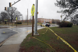 Crime scene tape is used around Great Mills High School, the scene of a shooting, Tuesday, March 20, 2018, in Great Mills.A student with a handgun shot two classmates inside the school before he was fatally wounded during a confrontation with a school resource officer, a sheriff said.  (AP Photo/Alex Brandon)