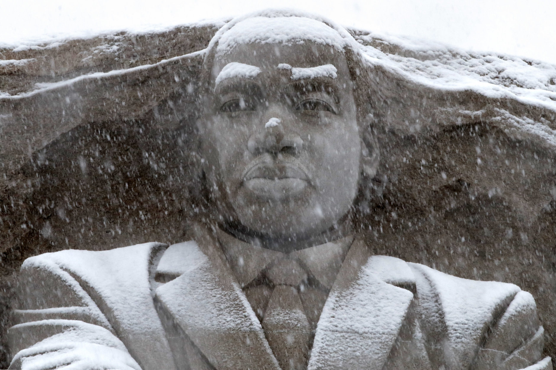 Snow falls on the Martin Luther King Jr., Memorial, Wednesday, March 21, 2018, in Washington, during a spring snow storm. (AP Photo/Jacquelyn Martin)