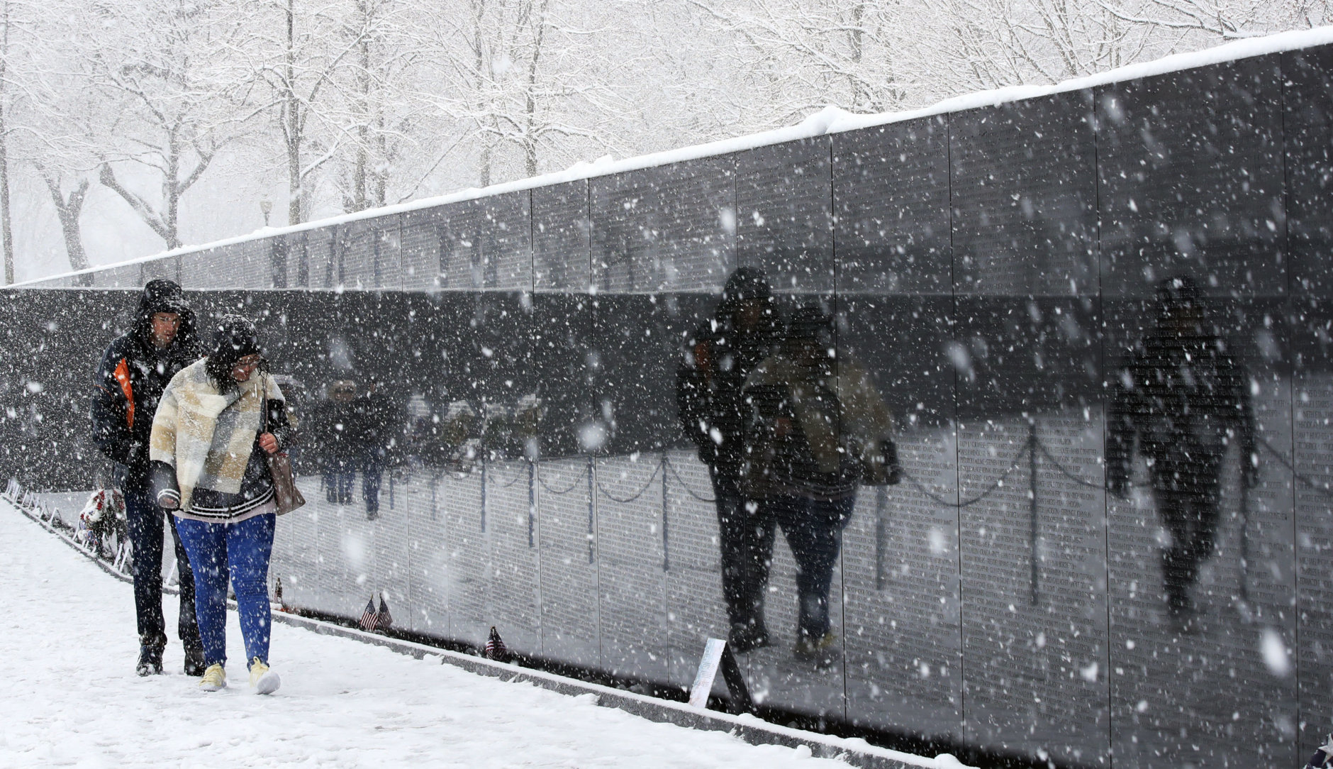 The Vietnam Veterans Memorial on the National Mall in Washington during the Spring snow storm, Wednesday, March 21, 2018. (AP Photo/Manuel Balce Ceneta)