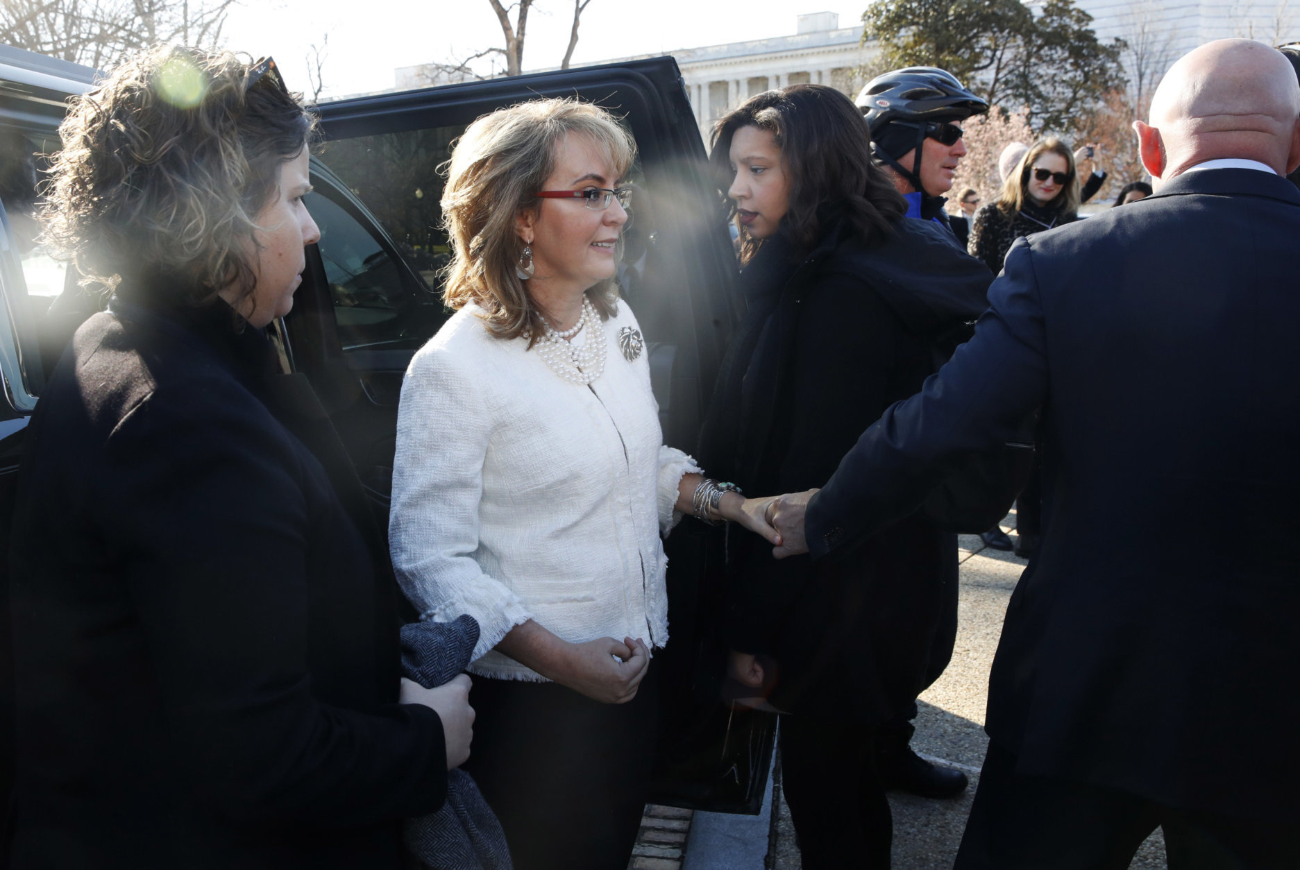 Gabby Giffords, center, is helped by her husband Mark Kelly, right, as they arrive for a news conference about gun violence, Friday,March 23, 2018, on Capitol Hill in Washington, ahead of the Saturday March For Our Lives. The conference was also attended by students and parents from Marjory Stoneman Douglas High School. (AP Photo/Jacquelyn Martin)
