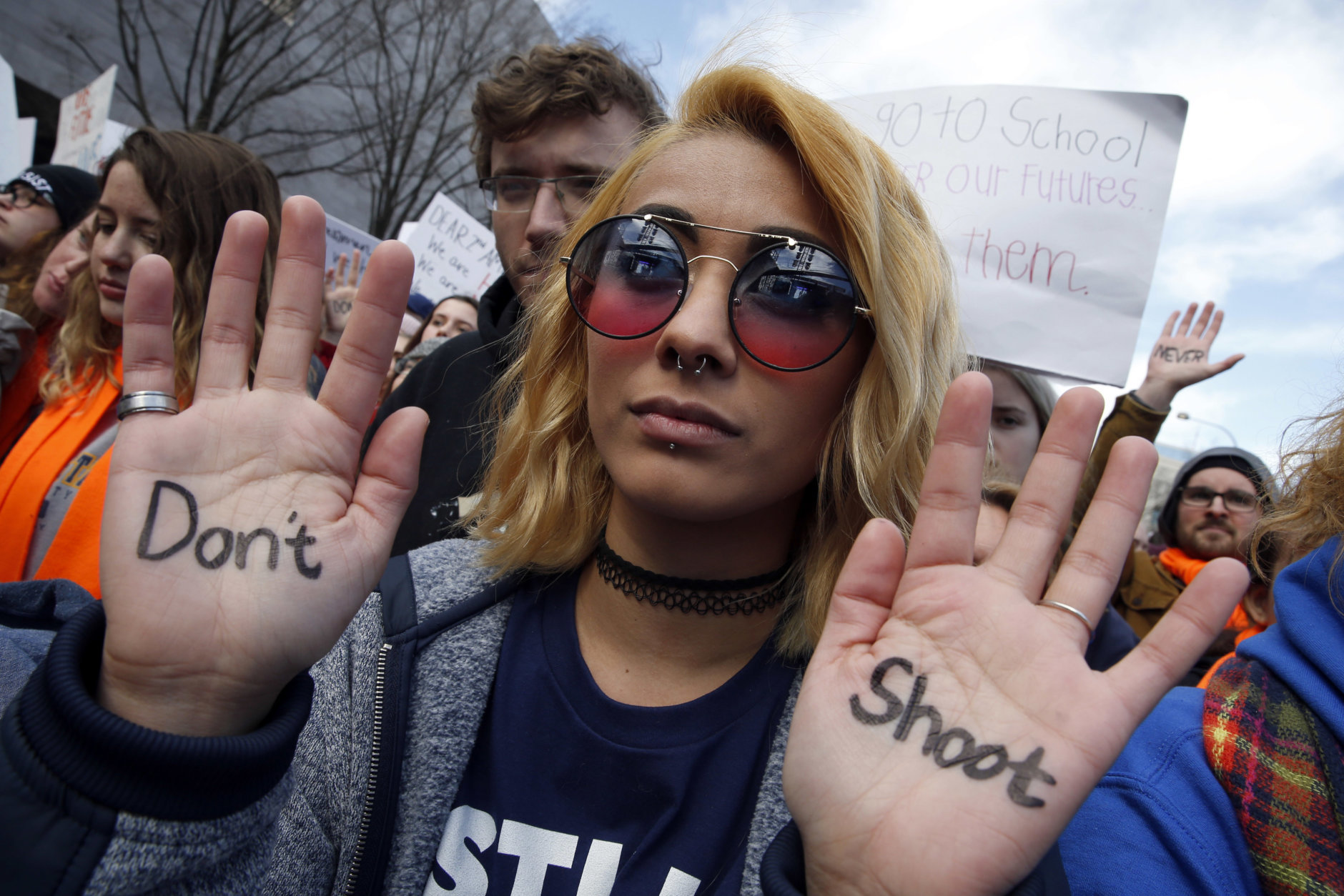 """Daisy Hernandez, 22, of Stafford, Va., wrote """"Don't Shoot,"""" on her hands during the """"March for Our Lives"""" rally in support of gun control, Saturday, March 24, 2018, in Washington. (AP Photo/Alex Brandon)"""