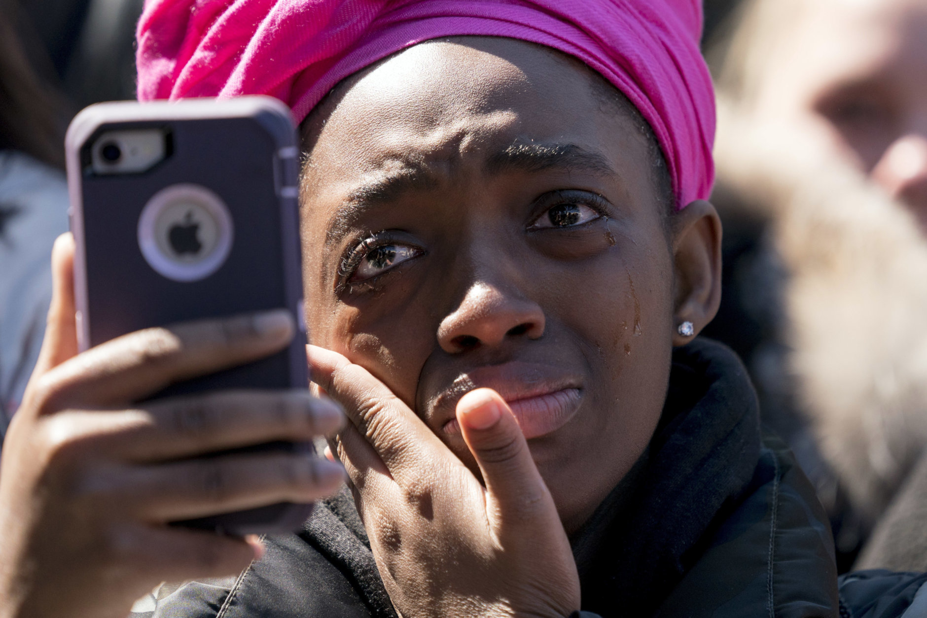 """A member of the audience becomes emotional as Zion Kelly, of Washington, who lost his twin brother Zaire to gun violence in the nation's capital in 2017, speaks during the """"March for Our Lives"""" rally in support of gun control in Washington, Saturday, March 24, 2018. (AP Photo/Andrew Harnik)"""