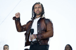 """Vic Mensa performs """"We Could Be Free"""" during the """"March for Our Lives"""" rally in support of gun control in Washington, Saturday, March 24, 2018. (AP Photo/Andrew Harnik)"""