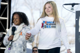 """Yolanda Renee King, grand daughter of Martin Luther King Jr., left, accompanied by Jaclyn Corin, a student at Marjory Stoneman Douglas High School in Parkland, Fla., and one of the organizers of the rally, right, speaks during the """"March for Our Lives"""" rally in support of gun control in Washington, Saturday, March 24, 2018. (AP Photo/Andrew Harnik)"""