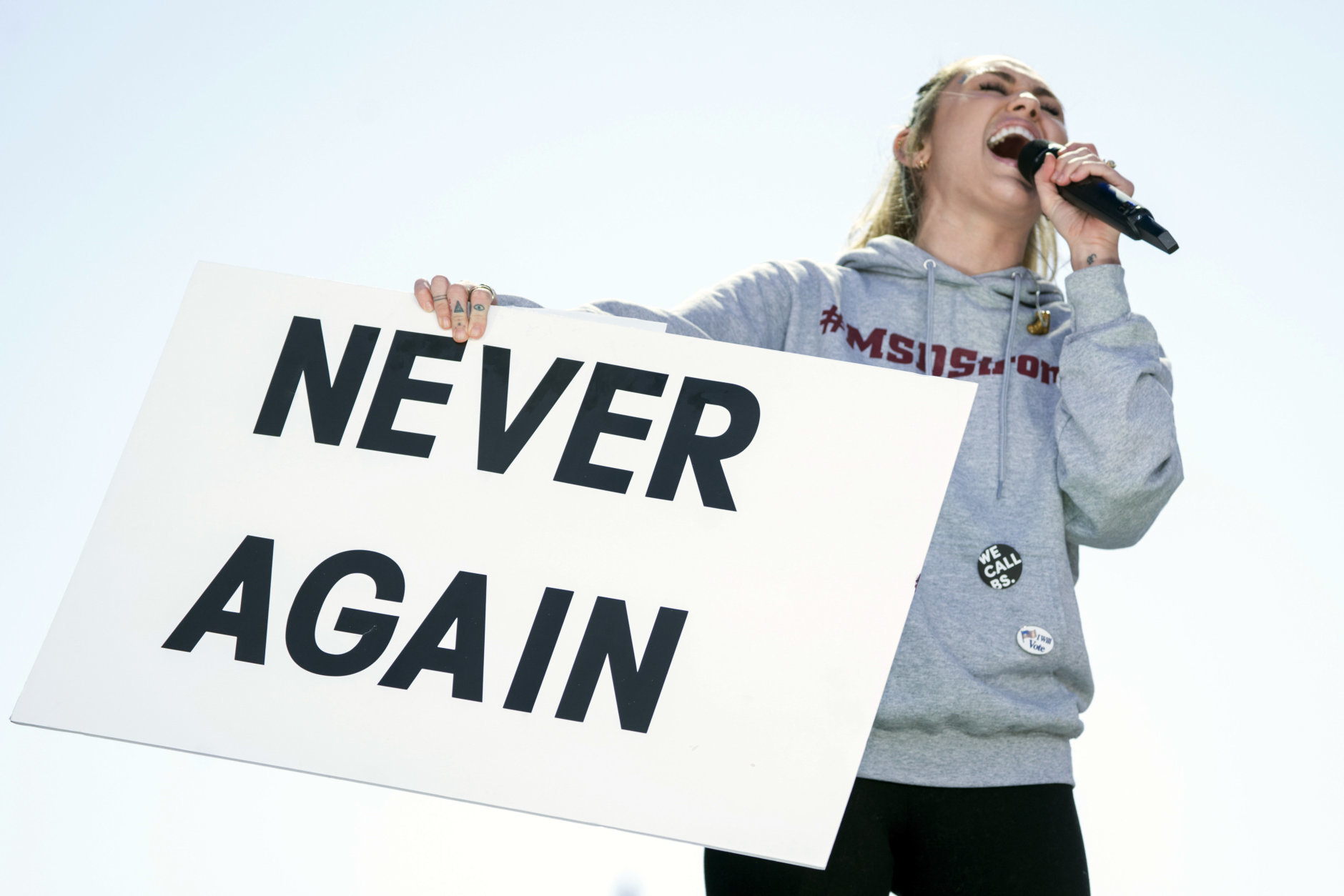 """Miley Cyrus performs """"The Climb"""" during the """"March for Our Lives"""" rally in support of gun control in Washington, Saturday, March 24, 2018. (AP Photo/Andrew Harnik)"""