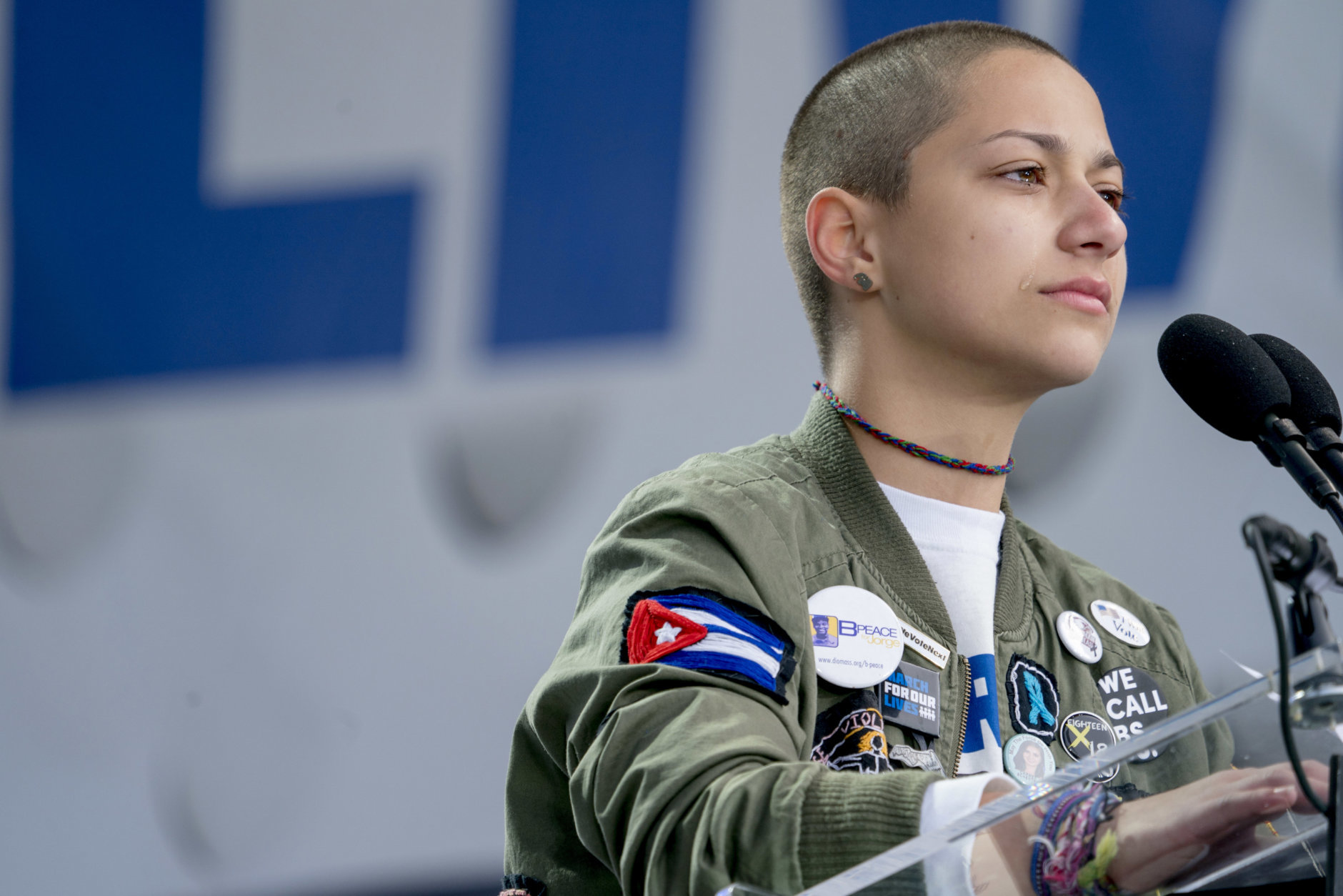 """Emma Gonzalez, a survivor of the mass shooting at Marjory Stoneman Douglas High School in Parkland, Fla., closes her eyes and cries as she stands silently at the podium and times the amount of time it took the Parkland shooter to go on his killing spree during the """"March for Our Lives"""" rally in support of gun control in Washington, Saturday, March 24, 2018. (AP Photo/Andrew Harnik)"""