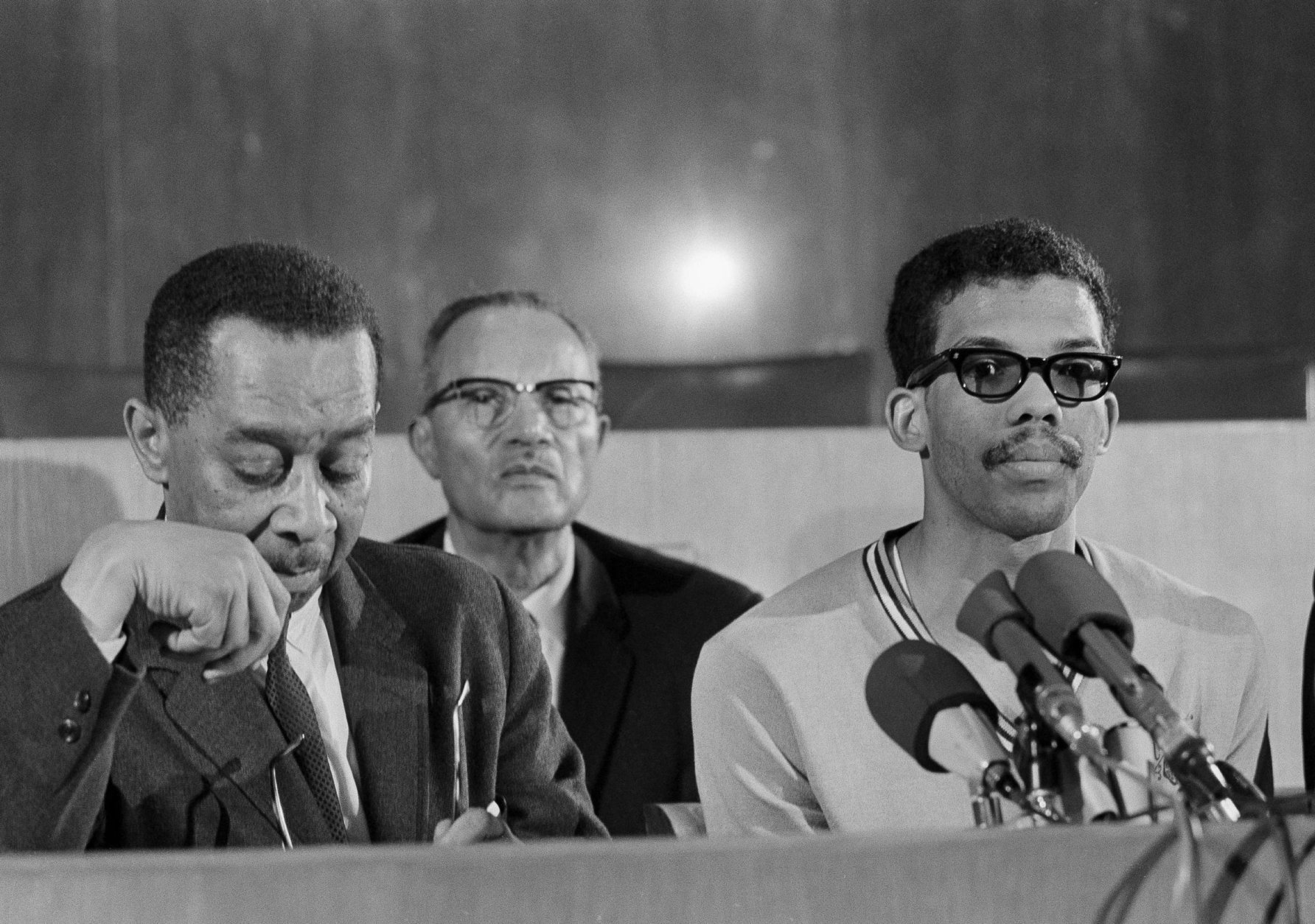 Dr. Kenneth Clark, New York psychologist and member of the board of trustees of Howard University, speaks at a news conference which student leaders in Washington, D.C., March 23, 1968. From left: Clark, Edward Brown, student council president, Tony Gittens and Q. T. Jackson. (AP Photo/Bob Schutz)